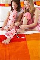 Girl's Painting Toe Nails    Stock Photo - Premium Royalty-Freenull, Code: 600-00866084