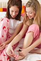 Girl's Painting Toe Nails    Stock Photo - Premium Royalty-Free, Artist: Masterfile, Code: 600-00866085