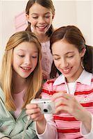 Girls Looking at Digital Camera    Stock Photo - Premi