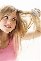 Girl Brushing Hair    Stock Photo - Premium Royalty-Freenull, Code: 600-00866221