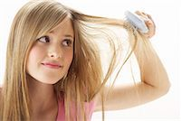 Girl Brushing Hair    Stock Photo - Premium Royalty-Freenull, Code: 600-00866222