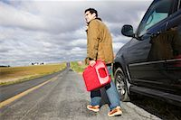 stalled car - Man Carrying Gas Can on Country Road    Stock Photo - Premium Royalty-Freenull, Code: 600-00866958