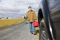 stalled car - Man With Gas Can, Trying To Hitch a Ride    Stock Photo - Premium Royalty-Freenull, Code: 600-00866959