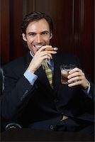 Wealthy businessman Stock Photo - Premium Royalty-Freenull, Code: 614-00891034