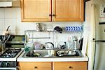 Kitchen with Dishes in the Sink    Stock Photo - Premium Rights-Managed, Artist: Steve Prezant, Code: 700-00897201