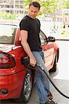 Man Pumping Gas    Stock Photo - Premium Rights-Managed, Artist: Mike Randolph, Code: 700-00897280