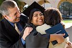 Graduate Hugging Parents    Stock Photo - Premium Rights-Managed, Artist: Tim Mantoani, Code: 700-00897739
