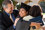 Graduate Hugging Parents    Stock Photo - Premium Rights-Managed, Artist: Tim Mantoani, Code: 700-00897740