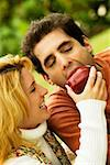 Close-up of a young woman feeding an apple to a mid adult man Stock Photo - Premium Royalty-Free, Artist: Philip Rostron, Code: 625-00899416