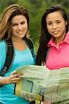 Portrait of two young women holding a map Stock Photo - Premium Royalty-Freenull, Code: 625-00900211