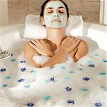 High angle view of a young woman wearing a facial mask in a bathtub Stock Photo - Premium Royalty-Free, Artist: Harald Vorsteher, Code: 625-00901552