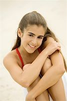 preteen beach - Portrait of a girl sitting on the beach smiling Stock Photo - Premium Royalty-Freenull, Code: 625-00902622