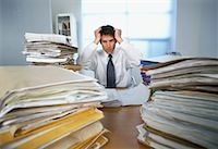 Businessman Surrounded By Paperwork    Stock Photo - Premium Rights-Managednull, Code: 700-00909716