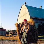 Farmer Using Cellular Phone    Stock Photo - Premium Rights-Managed, Artist: Masterfile, Code: 700-00910102