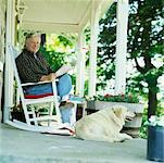 Man and Dog on Porch    Stock Photo - Premium Rights-Managed, Artist: Masterfile, Code: 700-00910119