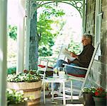 Man Reading Newspaper on Front Porch    Stock Photo - Premium Rights-Managed, Artist: Masterfile, Code: 700-00910121