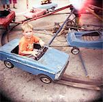 Boy Riding Toy Car At Playground, Cuba    Stock Photo - Premium Rights-Managed, Artist: oliv, Code: 700-00910327