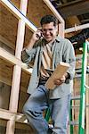 Carpenter Talking on Cell Phone    Stock Photo - Premium Royalty-Free, Artist: Fabio Cardoso, Code: 600-00910772