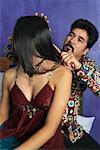 Man Brushing Woman's Hair