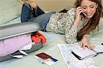 Woman Talking on Phone, Planning Vacation    Stock Photo - Premium Rights-Managed, Artist: Siephoto, Code: 700-00911729
