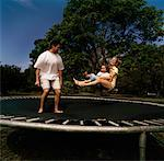 Family on Trampoline    Stock Photo - Premium Rights-Managed, Artist: TSUYOI, Code: 700-00916909
