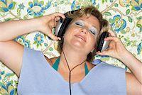 Woman Listening to Music    Stock Photo - Premium Royalty-Freenull, Code: 600-00917108