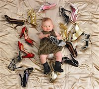 Baby Surrounded by Shoes    Stock Photo - Premium Royalty-Freenull, Code: 600-00917278