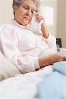 sleepy old woman - Portrait of Woman in Bed    Stock Photo - Premium Royalty-Freenull, Code: 600-00917409