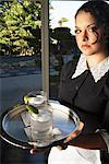 A Maid Holding Tray With Drinks    Stock Photo - Premium Royalty-Free, Artist: Masterfile, Code: 600-00917519