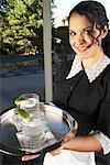 A Maid Holding Tray With Drinks    Stock Photo - Premium Royalty-Free, Artist: Masterfile, Code: 600-00917520