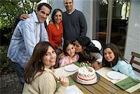 Family At Girl's Birthday Party Outdoors    Stock Photo - Premium Rights-Managed, Artist: Masterfile, Code: 700-00918156