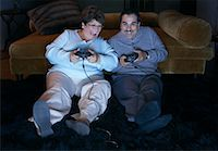 fat lady sitting - Couple Playing Video Games    Stock Photo - Premium Rights-Managednull, Code: 700-00918257