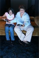 fat lady sitting - Mother and Daughter Playing Video Games    Stock Photo - Premium Rights-Managednull, Code: 700-00918268