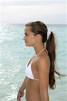 Young girl wearing bikini, standing at the beach Stock Photo - Premium Royalty-Freenull, Code: 628-00919176