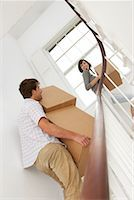 Couple Moving Boxes Upstairs in New House    Stock Photo - Premium Rights-Managednull, Code: 700-00933773