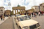 Taxis and Tourists in City Square, Pariser Platz, Berlin, Germany