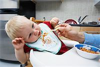 Parent Feeding Spaghetti to Boy in High Chair    Stock Photo - Premium Rights-Managednull, Code: 700-00934490