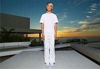 Portrait of Boy Standing on Patio    Stock Photo - Premium Royalty-Freenull, Code: 600-00934659