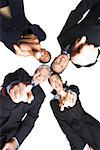 Businesspeople in huddle/ Stock Photo - Premium Royalty-Free, Artist: Anne Wirtz, Code: 604-00936286