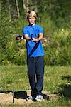 Teenager playing horseshoes/ Stock Photo - Premium Royalty-Free, Artist: Masterfile, Code: 604-00937415