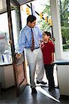 Father and son in doorway/ Stock Photo - Premium Royalty-Free, Artist: Ron Fehling, Code: 604-00937637