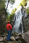 Man standing next to waterfall/ Stock Photo - Premium Royalty-Free, Artist: Sheltered Images, Code: 604-00941417