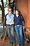 Couple with skateboards/ Stock Photo - Premium Royalty-Free, Artist: Masterfile, Code: 604-00941623