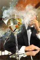 Man Smoking a Cigar/ Stock Photo - Premium Royalty-Freenull, Code: 604-00942313