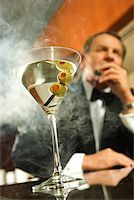 Man Smoking a Cigar/ Stock Photo - Premium Royalty-Freenull, Code: 604-00942314