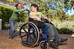 Sister Pushing Brother in Wheelchair    Stock Photo - Premium Royalty-Free, Artist: Masterfile, Code: 600-00949017