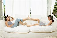 preteen girl feet - Girls Playing on Couch    Stock Photo - Premium Royalty-Freenull, Code: 600-00954254