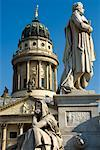 Statues in Gendarmenmarkt, German Cathedral in Background, Berlin, Germany