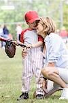 Mother and Son in Baseball Field    Stock Photo - Premium Rights-Managed, Artist: Kevin Dodge, Code: 700-00955374