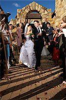 Newlyweds Leaving Church Stock Photo - Premium Royalty-Freenull, Code: 600-00955438